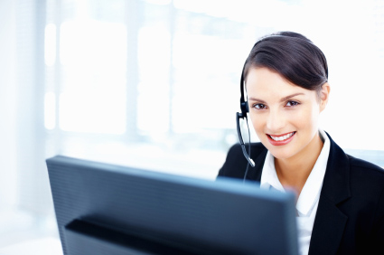 Beautiful smiling female customer representative wearing headset